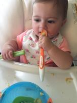 feeding herself